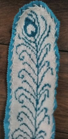 Intarsia knitting, mounted on craft felt